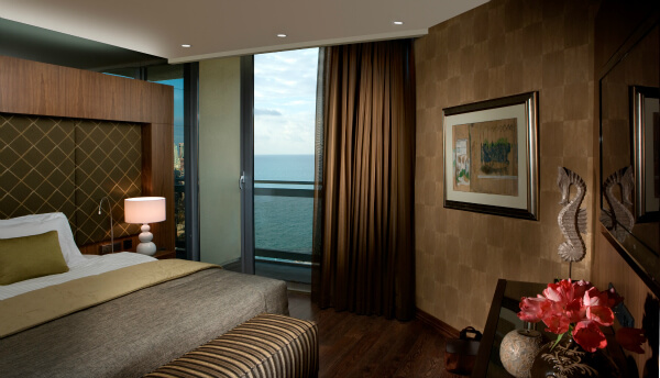 Accommodations at Dan Panaroma Tel Aviv include this suite bedroom