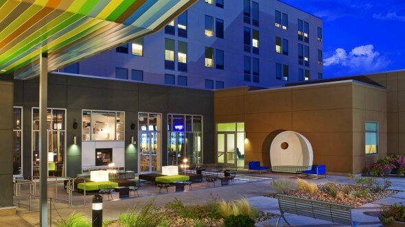 "The Aloft Broomfield Denver's ""backyard"" is an oOutdoor patio"