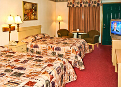 a two queen bed room at Vacation Lodge