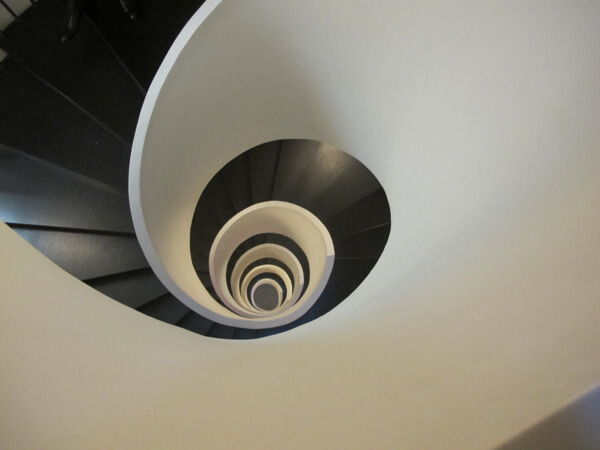 Looking down the designer staircase from the 6th floor