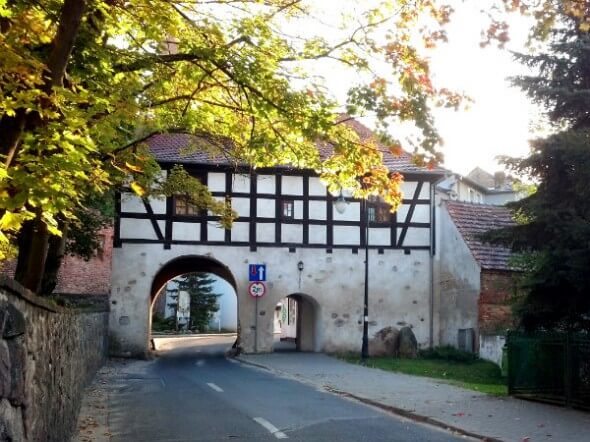 The road through the Lagow town gate leads to the Hotel Zamek Joannitow