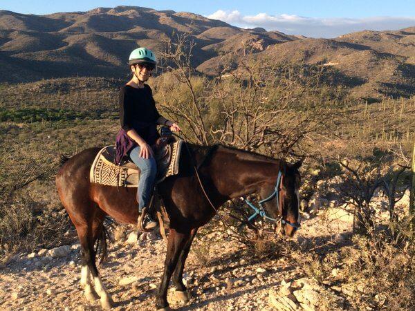 Carolyn rides a horse