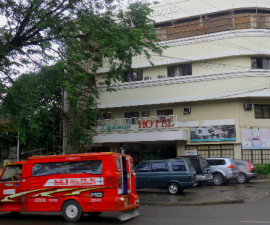 A jeepney, a typical type of public transportation goes by the Diplomat Hotel
