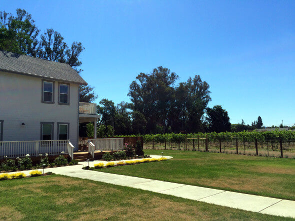 The Napa Vineyard House is surrounded by vineyards