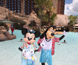 MICKEY MOUSE AND GOOFY DIP THEIR FEET IN WAIKOLOHE POOL -- With its fun recreation features and restaurants, its comfortable rooms, and its combination of Disney magic with Hawaiian beauty, tradition and relaxation, Aulani, a Disney Resort & Spa in Hawai'i, offers a new way for families to vacation together on the island of O'ahu. (Paul Hiffmeyer/Disney Destinations)