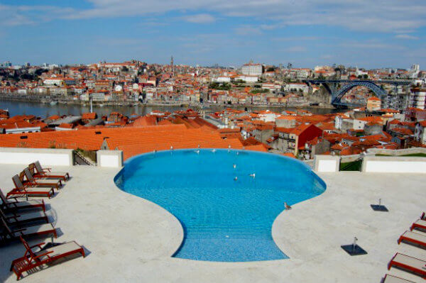 The decanter-shaped pool at the Yeatman Hotel in Porto carries out the wine theme