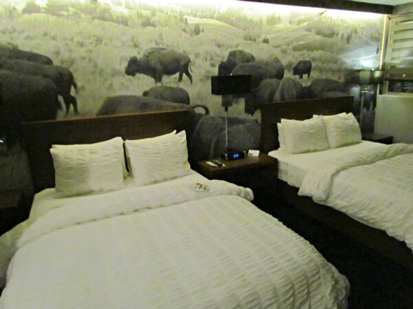 Stampeding buffalo mural on renovated 8th floor of Adoba Eco Hotel