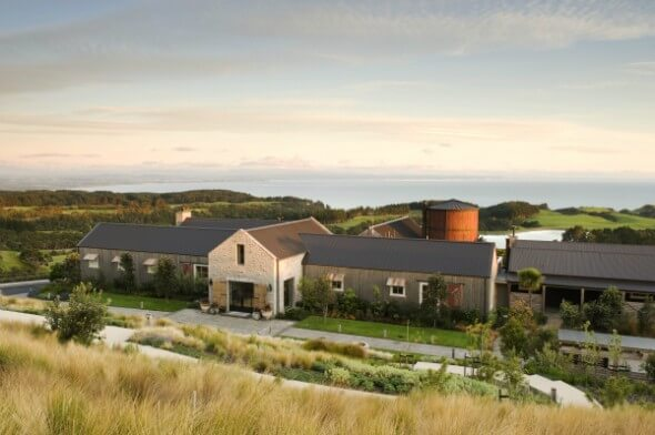 Front view of the Farm at Cape Kidnappers with its cluster of farm buildings