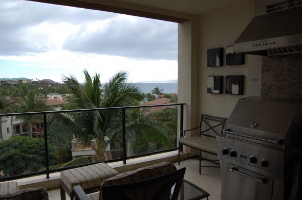 Lanai with grill and partial ocean view