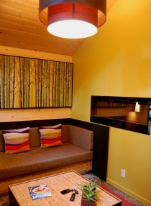 High ceilings and colorful decor help the cozy cabins feel spacious