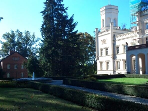 The other side of the main palace sits across from the brick office and a landscaped yard