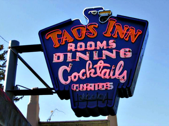 A neon sign marks the Historic Taos Inn, New Mexico
