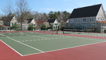 The tennis courts include basketball hoops
