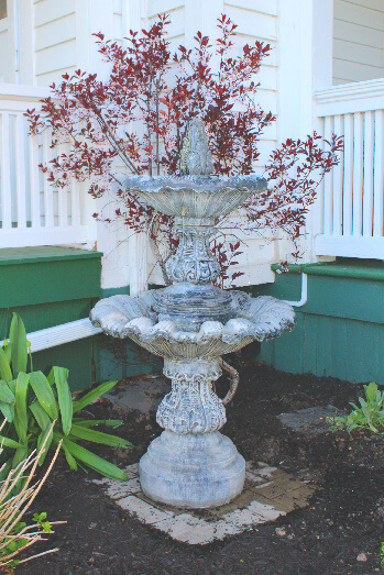 A fountain and flowerbed detail.