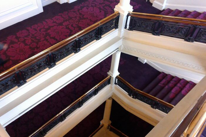 on the grand staircase at Amba Charing Cross