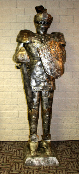 A knight's armor greets guests at check-in.
