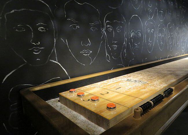 Table shuffleboard in Hotel Zetta Playroom