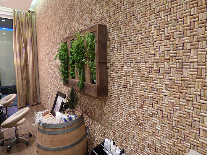 Spa lobby with wine cork wall and herbs