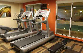 The fitness center overlooks the pool