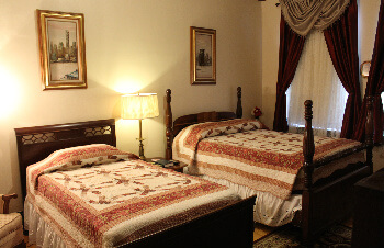 Room with a double and single bed