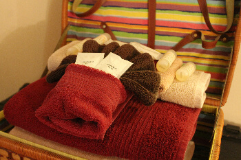 A basket of towels and toilettries