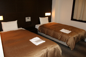 A standard two-twin bed room. It's not as small as it looks.