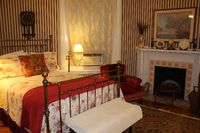 East Room- Double bed comfort comes with a fireplace