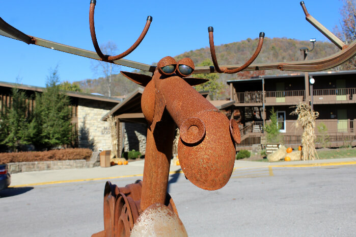 Sculpture moose with May Lodge in the background