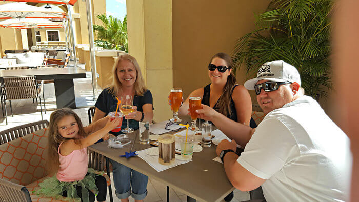 A toast to a Disney multigenerational family vacation at Four Seasons Resort Orlando at Ravello