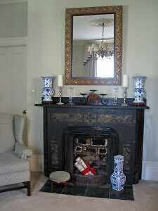 The black marble fireplaces are original to the Tattingstone Inn. (Photo by Susan McKee)