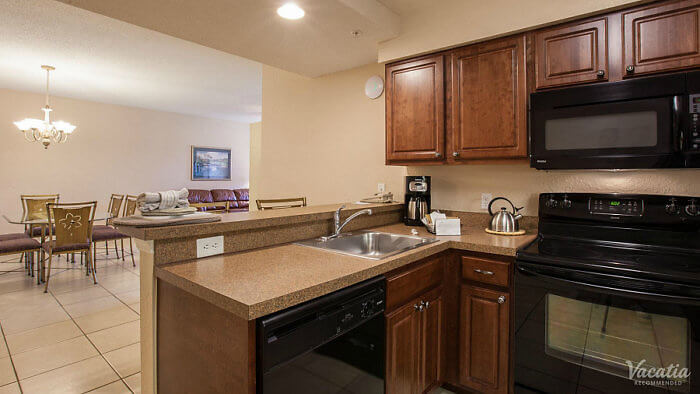 Our 2-bedroom villa includes a full kitchen with dining room at Mystic Dunes Resort.