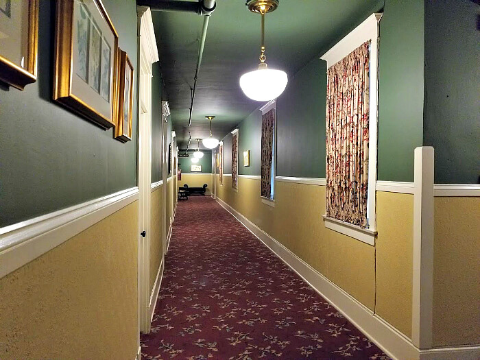 The hallways of the Hotel Boulderado include historic elements including ornate wallpaper, artwork and photography.
