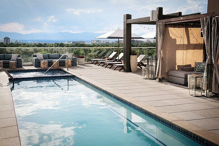 The upscale Denver neighborhood of Cherry Creek welcomed Halcyon in 201 and another Rooftop pool.