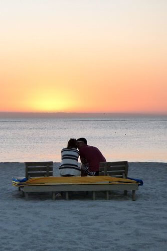 Sunset and romance in front of a resort on the white sands of St. Pete Beach in Tampa Bay, Florida