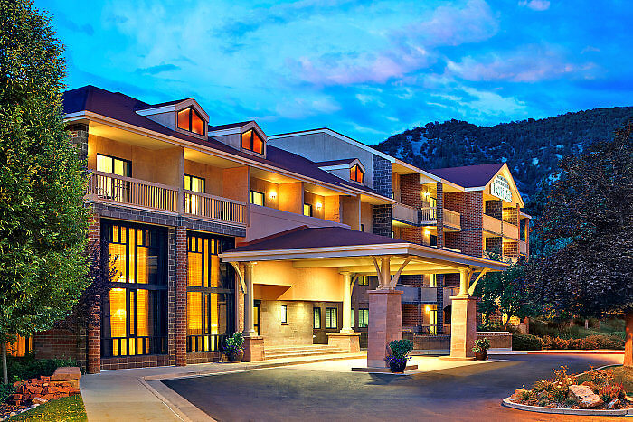 Located behind the hot springs pool, check into the Glenwood Hot Springs Resort in Glenwood Springs, Colorado