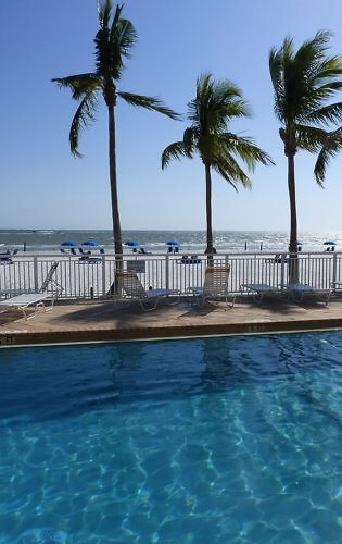View from the pool at Best Western Plus Beach Resort on the sand at Fort Myers Beach, Florida on the Gulf Coast.