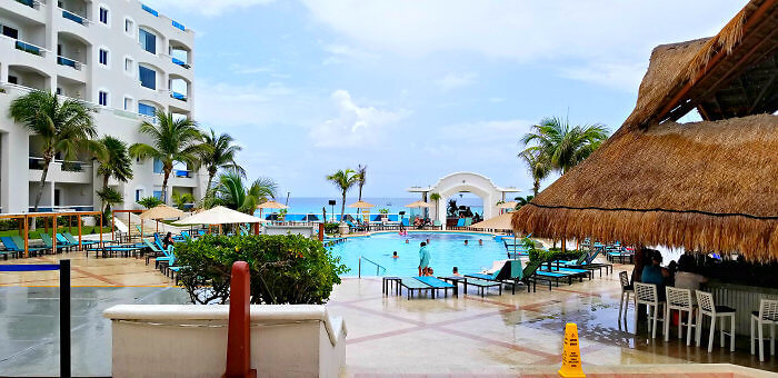 Step out of the lobby area into a view of pools and ocean at Panama Jack Resorts Cancun.