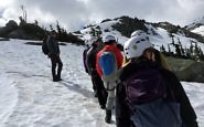 Hikers in the snow, Whistler BC Canada