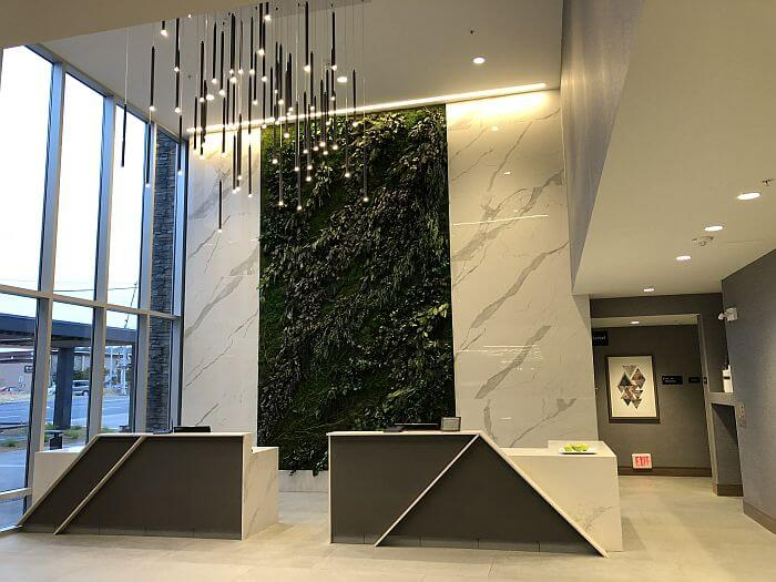 Green wall and lobby of Hotel Trio in Healdsburg
