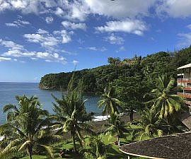 View from the balcony of a Premium Room with hot tub at Tahiti Pearl Beach Resort