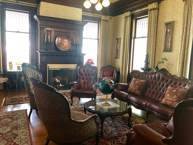 churchill manor bed and breakfast, churchill manor parlor with fireplace, historic napa inn, downtown napa inn