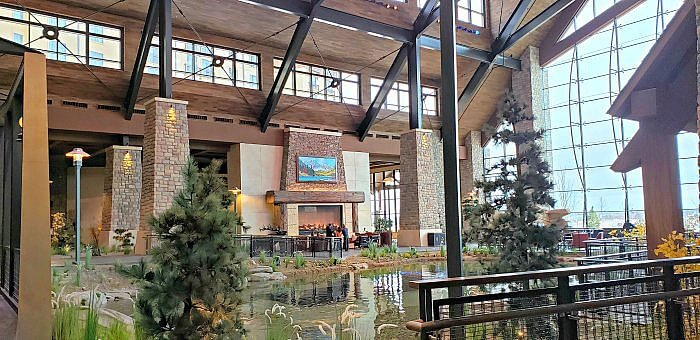 Gaylord Rockies resort & Convention Center, grand lodge and fireplace area near dining opintions and water feature.