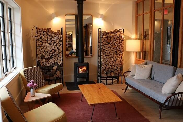 Common area with wood stove in Rivertown Lodge in Hudson, NY