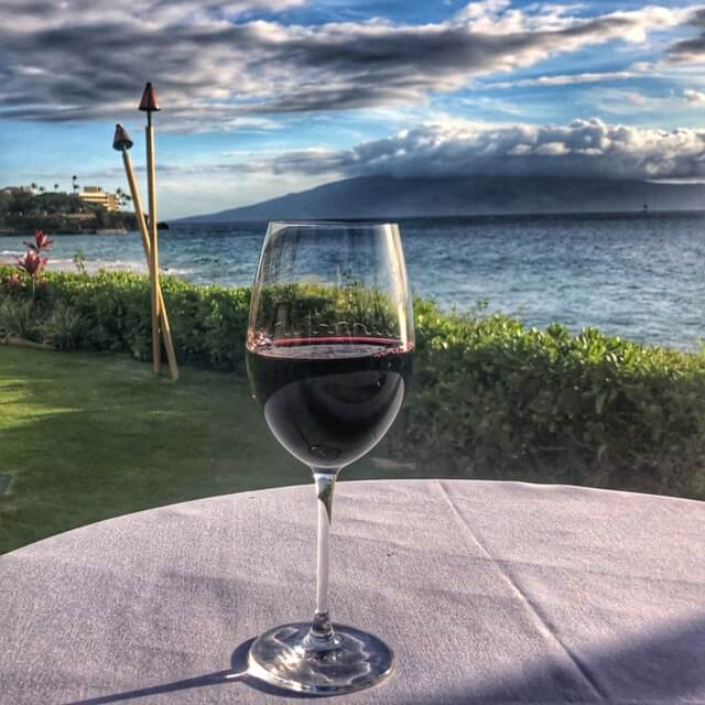 wine and view of the pacific ocean