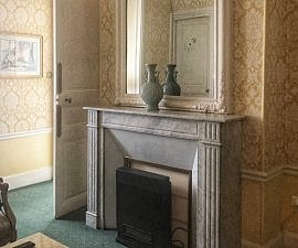 fireplace in junior suite at Westminster Hotel Paris