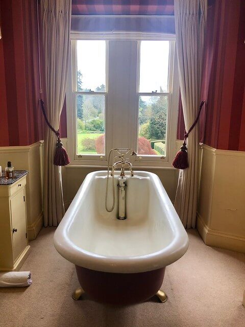 victorian roll top bath tub, gliffaes country house hotel room, crickhowell hotel room south wales