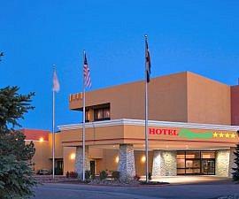 Hotel Eleganté Conference & Event Center, Exterior Porte Cochere at dusk of Crowne Plaza Colorado Springs Hotel