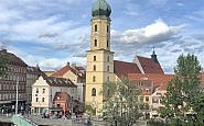 church, river mur, graz austria rooftops
