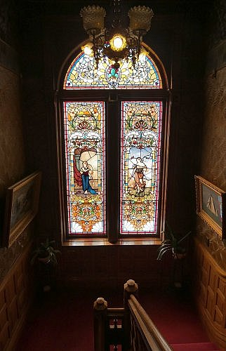 Stained glass windows lighting up the staircase at the Copper King Mansion Bed and Breakfast in Butte, Montana