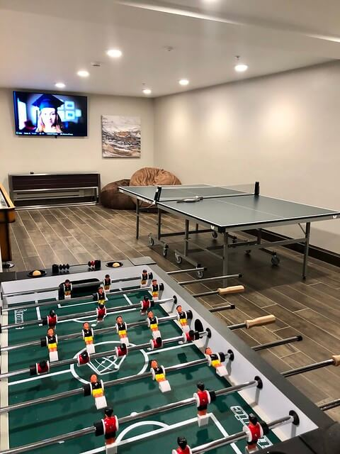 Hotel game room includes ping pong table, shuttleboard and foosball.